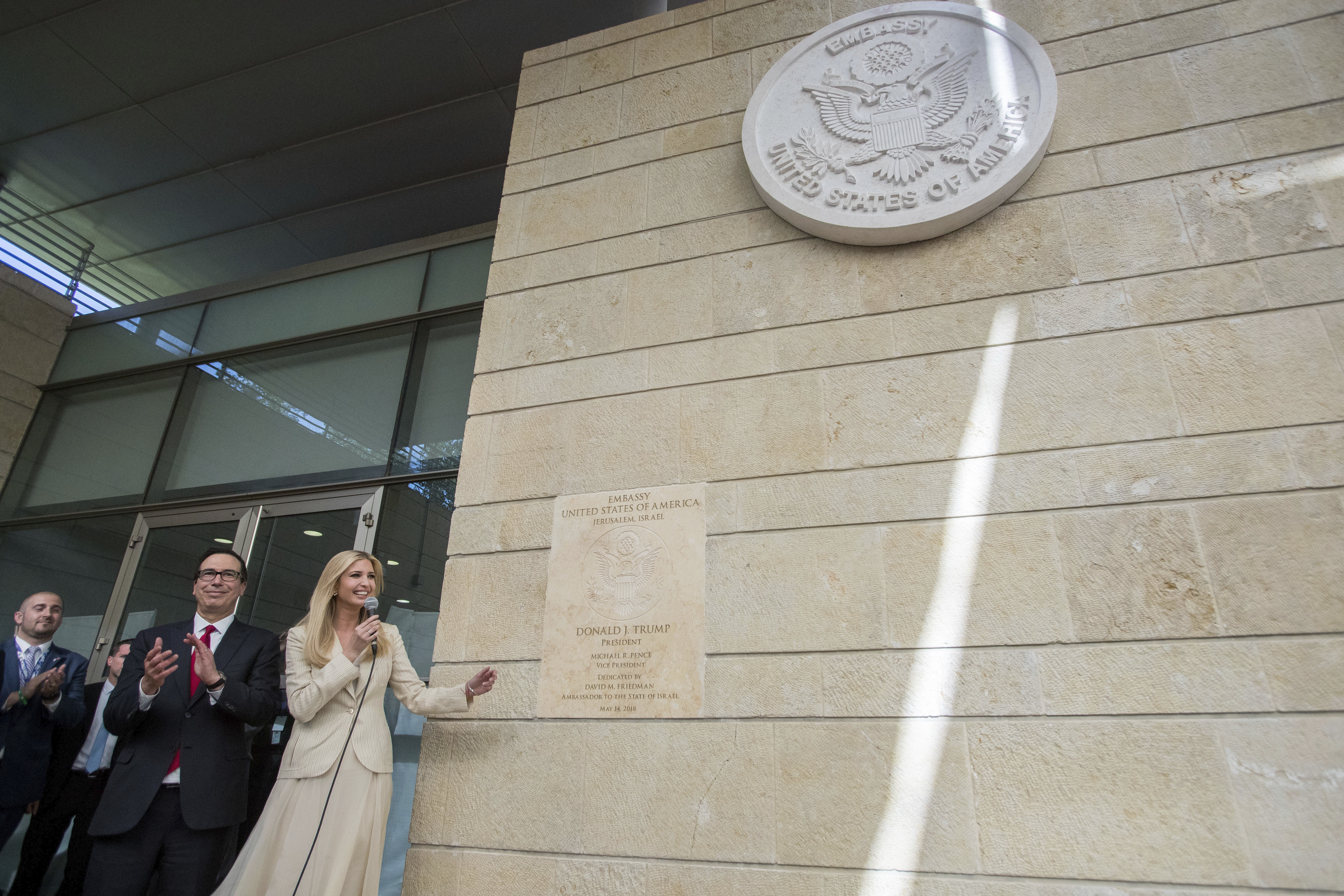 U.S. President Donald Trump's daughter Ivanka, right, and U.S. Treasury Secretary Steve Mnuchin during the opening ceremony of the new US embassy in Jerusalem, Monday, May 14, 2018. Amid deadly clashes along the Israeli-Palestinian border, President Donald Trump's top aides and supporters on Monday celebrated the opening of the new U.S. Embassy in Jerusalem as a campaign promised fulfilled. (Flash90 Photo/Yonatan Sindel via AP) ISRAEL OUT