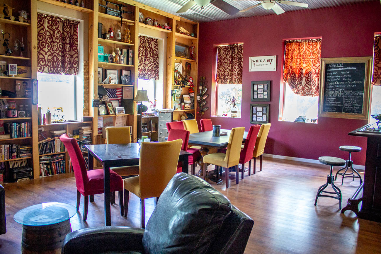 The couple renovated the upstairs into their living area while the first floor features two different tasting rooms. The main room has a bar, stage, and plenty of tables and games. The smaller room is filled with comfy seating and books. / Image: Katie Robinson, Cincinnati Refined // Published: 10.13.19