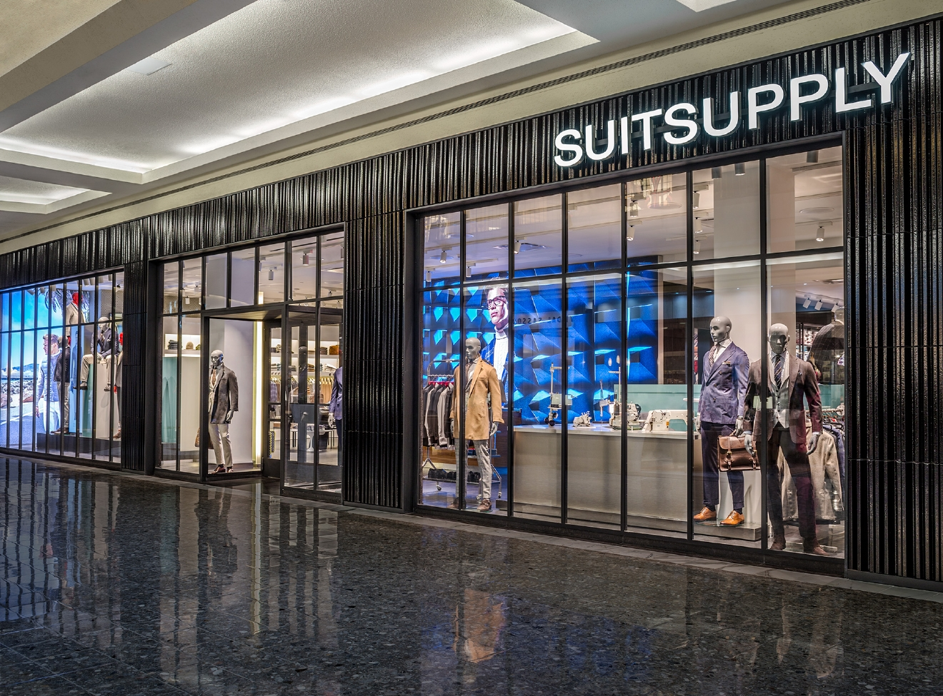 Suitsupply prides themselves on offering real suiting for real men that really fits. Tailoring is done in the store while you wait; allowing customers to leave with the perfect fitting suit all in a timely manner. (Suitsupply)