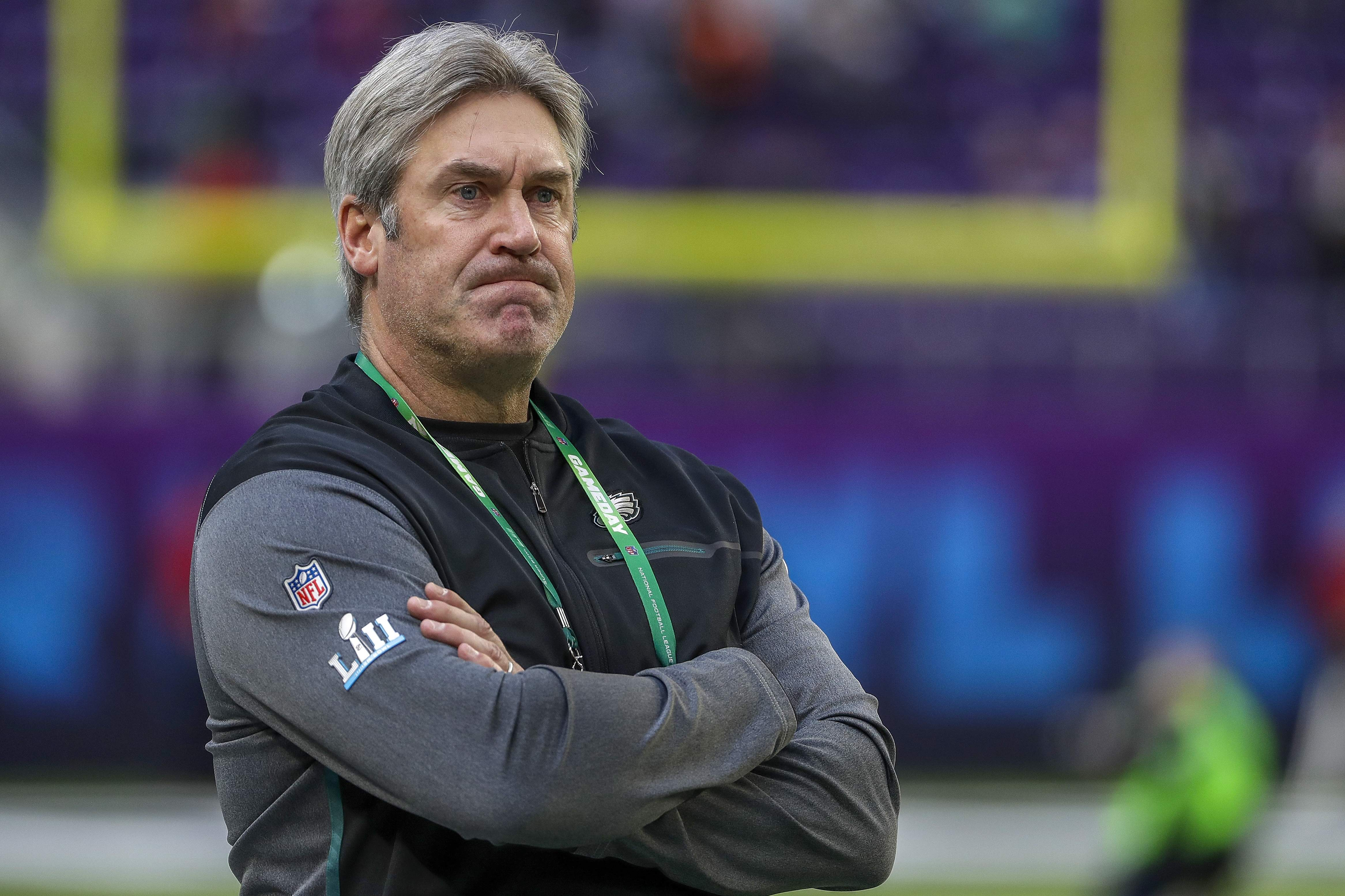 Philadelphia Eagles head coach Doug Pederson watches his team warm up before the NFL Super Bowl 52 football game against the New England Patriots Sunday, Feb. 4, 2018, in Minneapolis. (AP Photo/Matt Slocum)