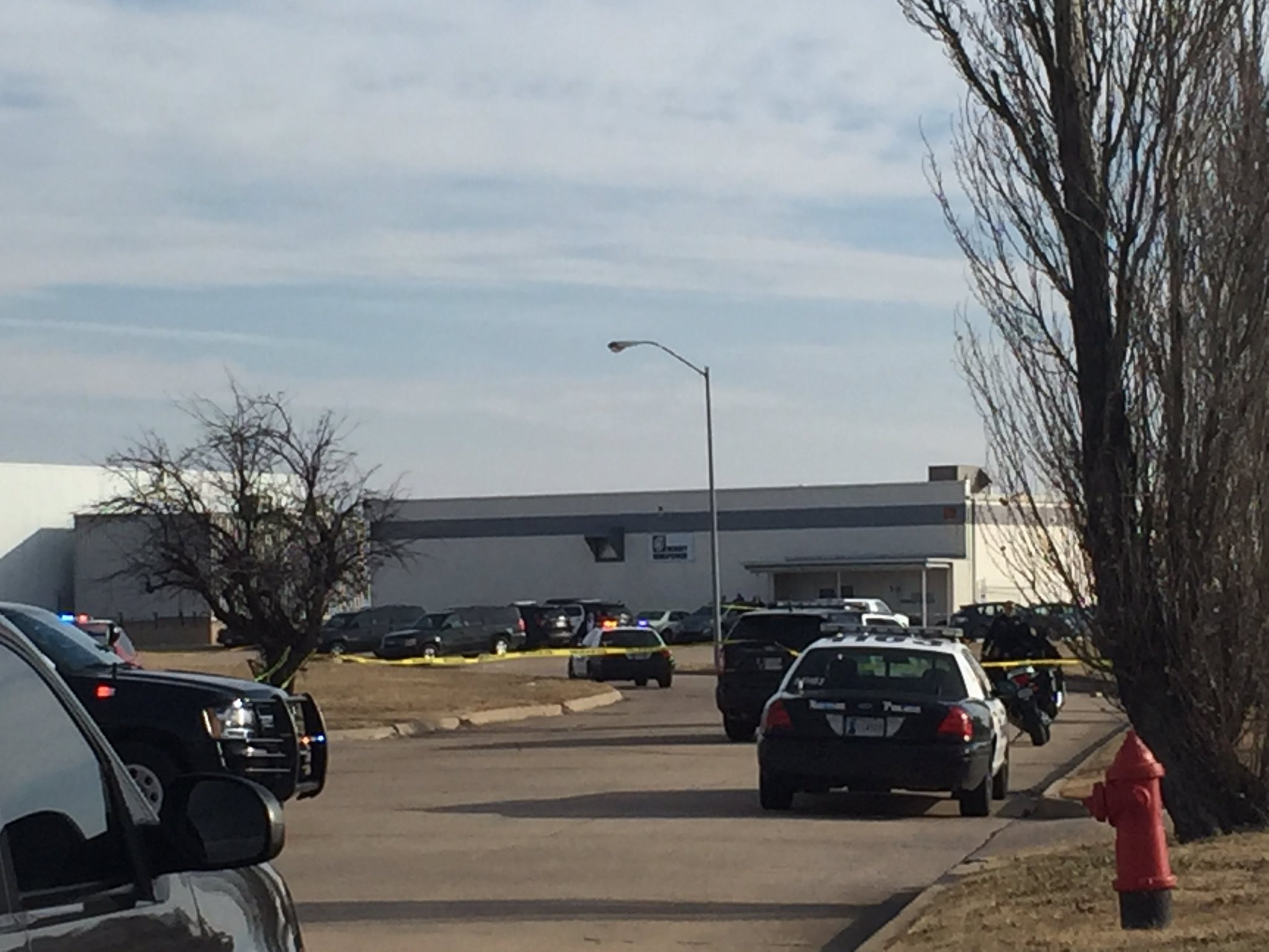 Police investigate an active shooter situation Jan. 10 at Bergey Windpower in Norman. (KOKH/Jordann Lucero)