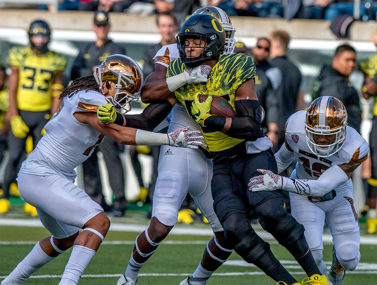 The Duck's Pharaoh Brown (#85) finds himself surrounded by Sun Devils. The Oregon Ducks broke their losing streak by defeating the ASU Sun Devils on Saturday 54-35. Photo by August Frank, Oregon News Lab