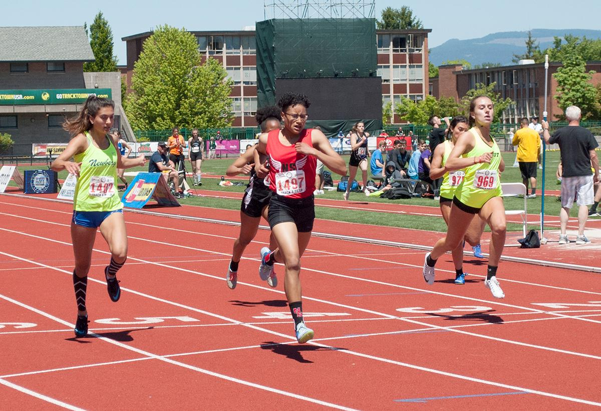 Rebekah Miller wins the Girl's 6A 200m dash overall with a time of 24.69 in the second heat at Hayward Field. Photo by Sheridan Kowta, Oregon News Lab
