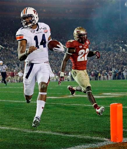 Auburn's Nick Marshall (14) gets past Florida State's Telvin Smith (22) for a touchdown run during the first half of the NCAA BCS National Championship college football game Monday, Jan. 6, 2014, in Pasadena, Calif.