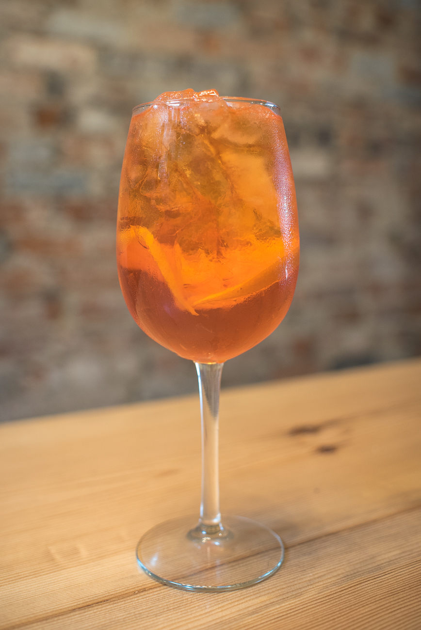 Aperol Spritz (Aperol and Prosecco with a splash of mineral water) / Image: Phil Armstrong, Cincinnati Refined // Published: 7.10.17