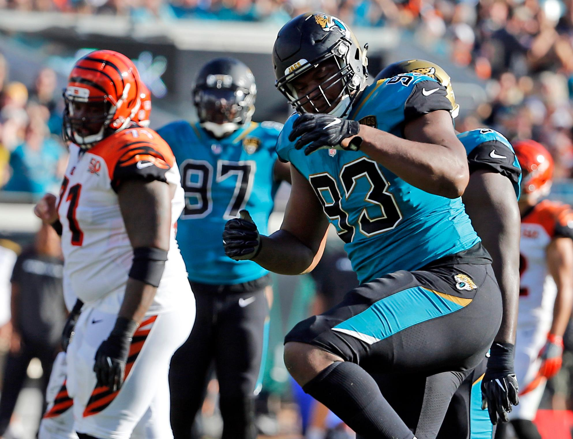 FILE - In this Sunday, Nov. 5, 2017, file photo, Jacksonville Jaguars defensive lineman Calais Campbell (93) celebrates a big play against the Cincinnati Bengals during the second half of an NFL football game  in Jacksonville, Fla. Two statistics often sway the voting for the defensive player of the year award: sacks and interceptions. Certainly the quarterback traps Jacksonville has gotten, led by Calais Campbell, have impressed the voters. (AP Photo/Stephen B. Morton, File)