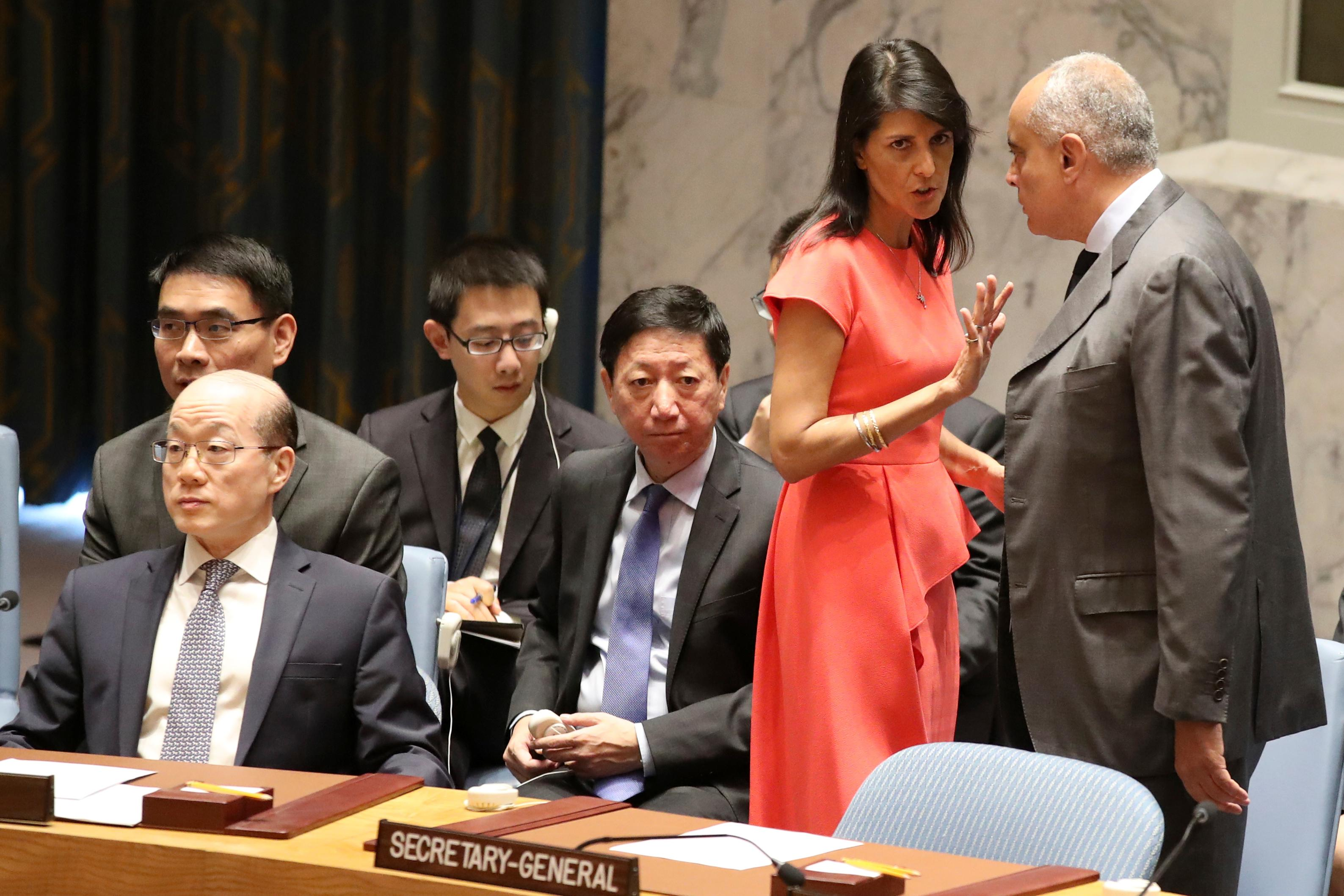 U.S. Ambassador to the United Nations Nikki Haley, left, speaks to Egyptian Ambassador and current Security Council President Amr Abdellatif Aboulatta before a Security Council vote on a new sanctions resolution that would increase economic pressure on North Korea to return to negotiations on its missile program, Saturday, Aug. 5, 2017 at U.N. headquarters. (AP Photo/Mary Altaffer)