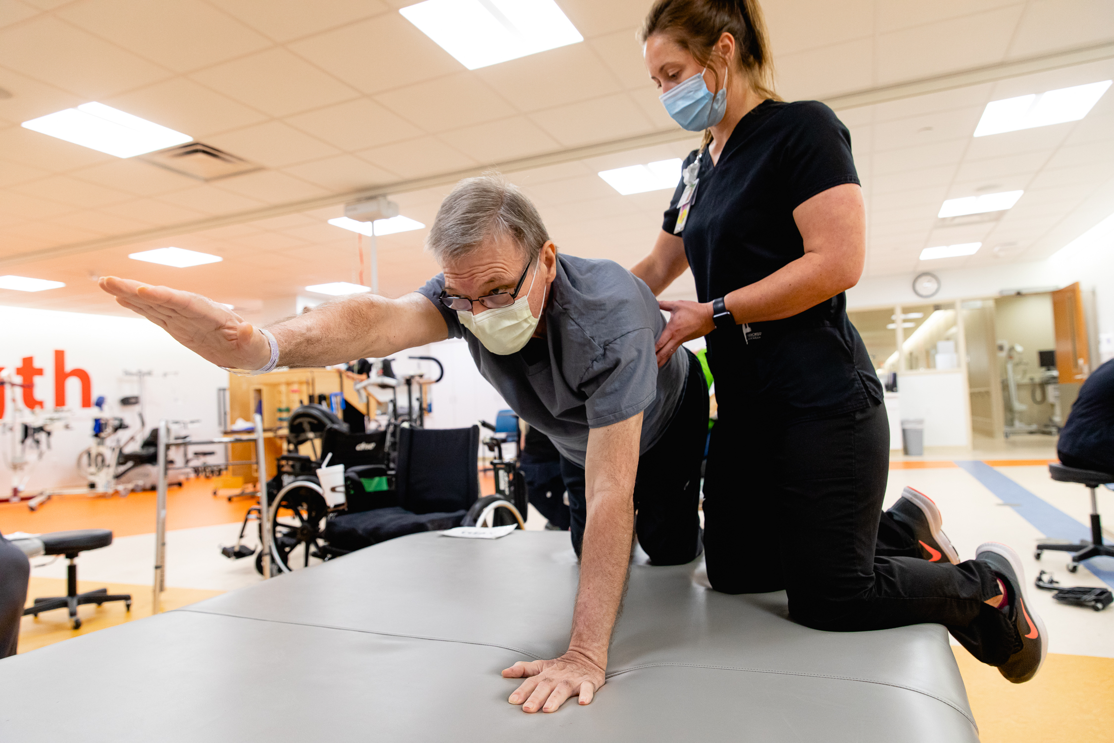 A Mary Free Bed staff member works with a patient during an individual session. Mary Free Bed Hospital is adding temporary additional beds to help area hospitals clear up space and focus on their patients with COVID-19.{ } (WWMT/Mary Free Bed Rehabilitation Hospital)