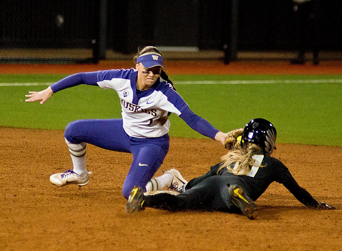 Huskies shortstop Ali Aguilar (#1) tags out Ducks Alexis Mack (#10). In Game Two of a three-game series, the University of Oregon Ducks softball team defeated the University of Washington Huskies 4-1 Friday night in Jane Sanders Stadium. Danica Mercado (#2), Alexis Mack (#10) and Mia Camuso (#7) all scored in the win, Mack twice. The Ducks play the Huskies for the tie breaker on Saturday with the first pitch at noon. Photo by Dan Morrison, Oregon News Lab