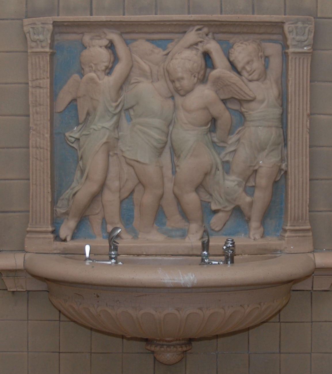 A Donatello Rookwood fountain depicting four dancing and singing cherub boys was donated by the class of 1912. It is located on the first floor in the east (main) corridor, south of the main entrance. / Image and research by Tim Jeffries // Published: 4.28.19
