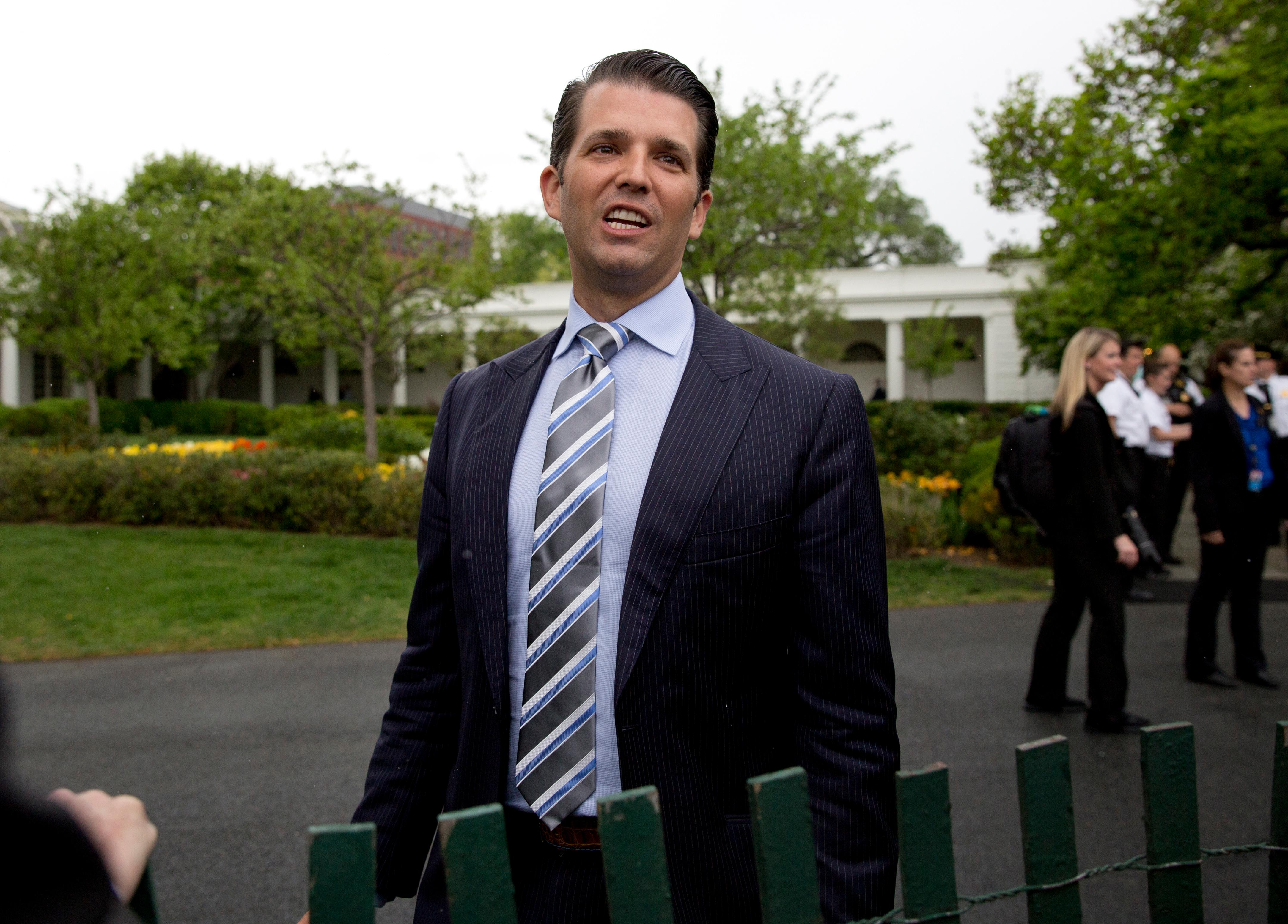 FILE - In this April 17, 2017, file photo, Donald Trump Jr., the son of President Donald Trump, speaks to media during the annual White House Easter Egg Roll on the South Lawn of the White House in Washington. At the heart of Donald Trump Jr.'s unusual campaign-season meeting with a Russian lawyer was an obscure sanctions law that has infuriated the Kremlin.  The Magnitsky Act, passed by Congress in 2012, was a U.S. response to the dubious death of a different Russian lawyer named Sergei Magnitsky. (AP Photo/Carolyn Kaster, File)