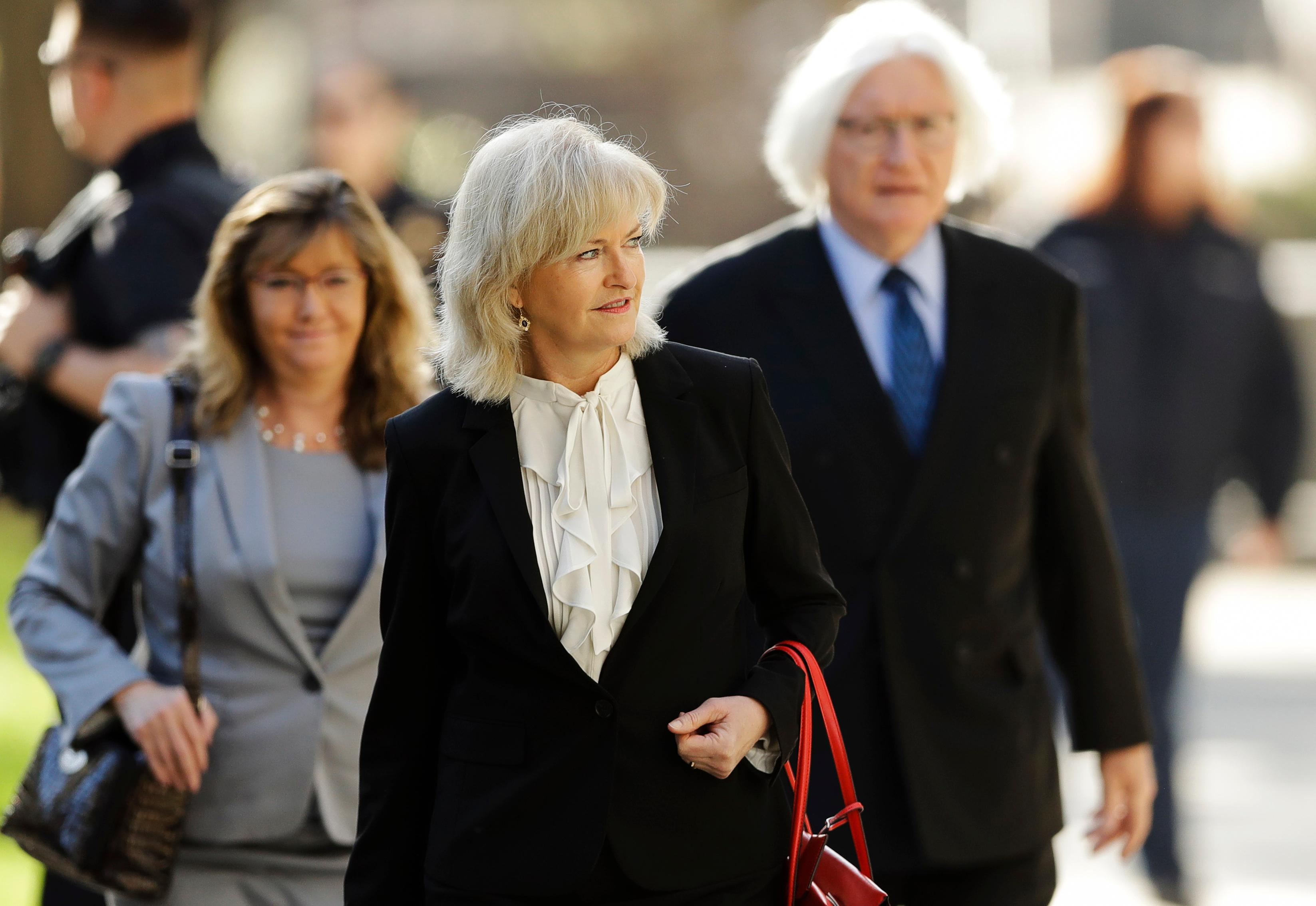 Attorney Kathleen Bliss, center, arrives for Bill Cosby's sexual assault trial, Monday, April 23, 2018, at the Montgomery County Courthouse in Norristown, Pa. (AP Photo/Matt Slocum)