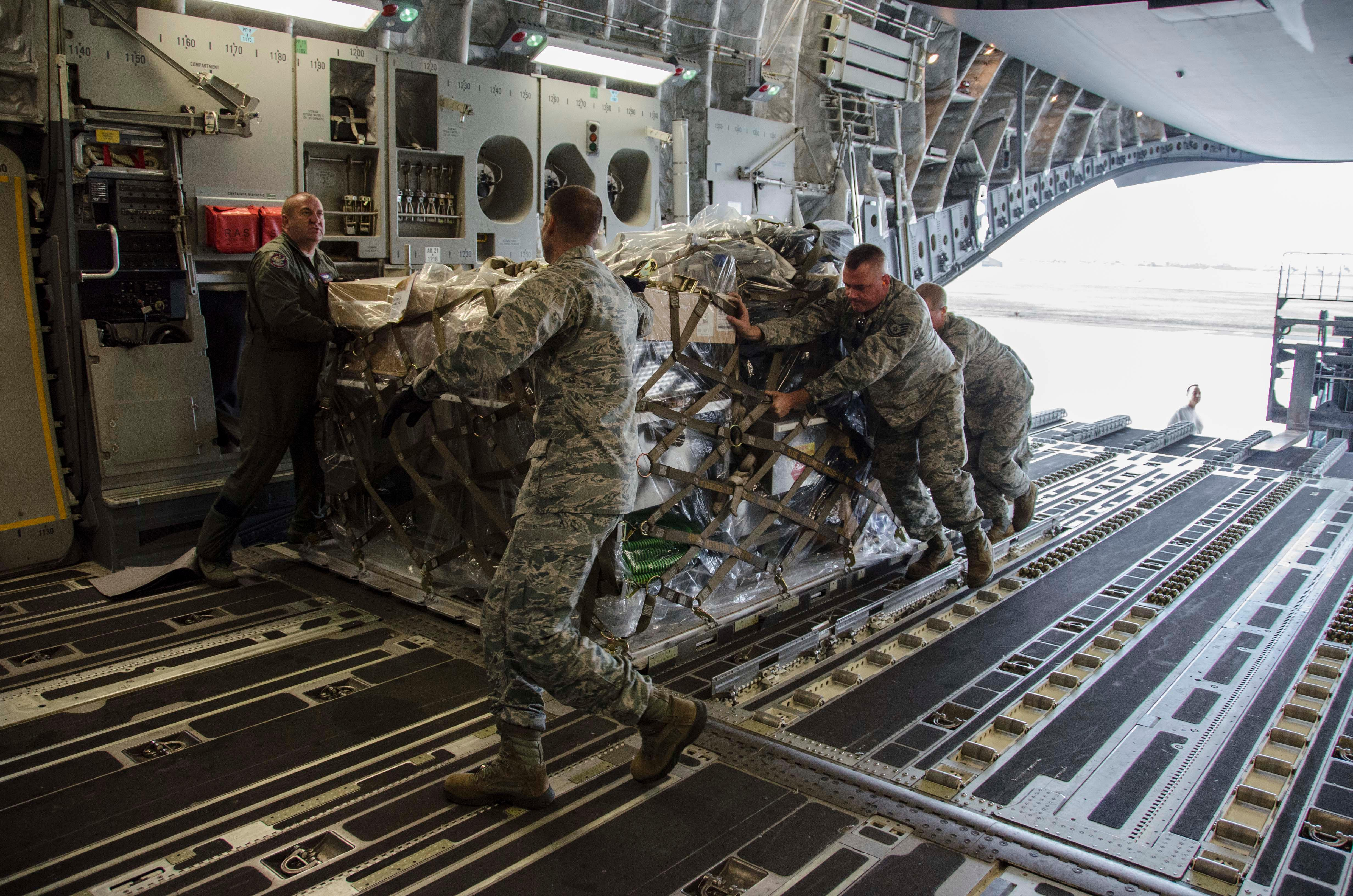A C-17 Globemaster cargo aircraft from the Mississippi Air National Guard is loaded with supplies as part of the support package from the Wisconsin Air National Guard heading to Puerto Rico for disaster relief Sept. 29, 2017. (Wisconsin Air National Guard photo by Master Sgt. Kellen Kroening/Released)