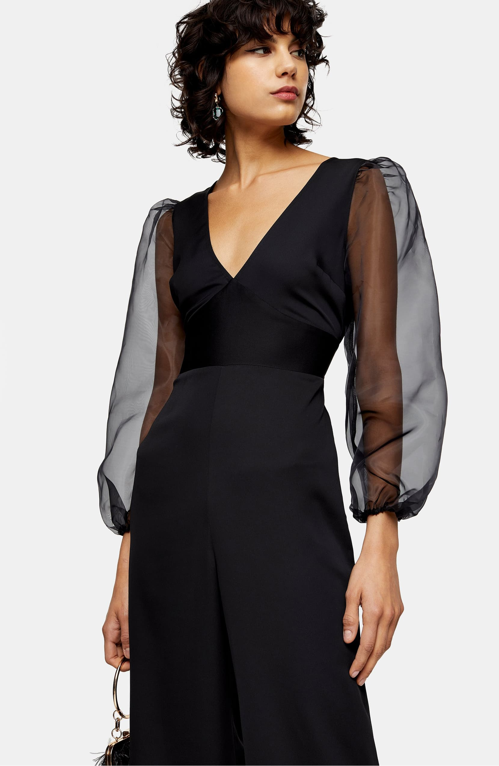 Gauzy organza sleeves add modern drama to a wide-leg jumpsuit that's destined to be a wardrobe standout. Shop it{ }- $95 (Image: Nordstrom){ }