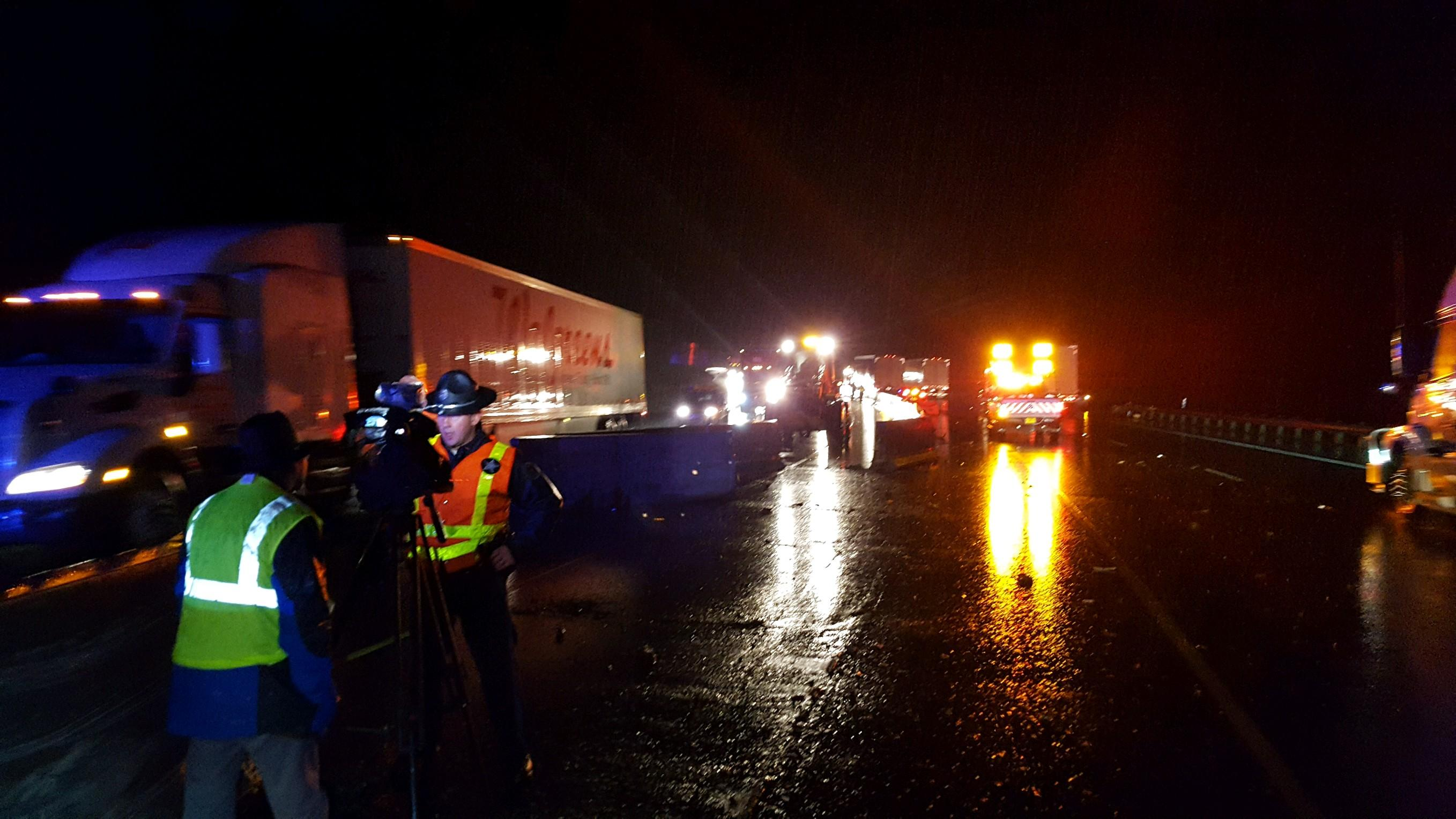 A truck driver lost control on Interstate 5 and crashed in the center concrete barrier, pushing sections of the barrier into oncoming traffic Wednesday night, Oregon State Police said. Four vehicles hit the barriers, and a pickup truck hit a commercial truck driver who stopped to try to warn other motorists, according to police. (OSP)