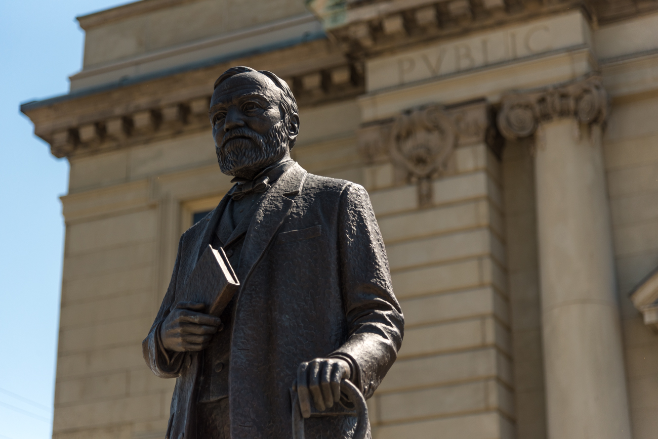 The statue in front of The Carnegie was forged in the likeness of Andrew Carnegie himself. It was gifted to building by Eva G. Farris. / Image: Phil Armstrong, Cincinnati Refined // Published: 5.18.17