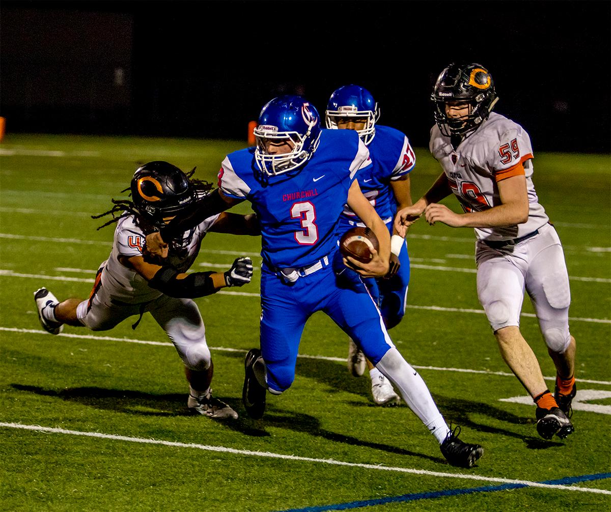 Churchill's Brandon Good (#3) runs away from the Crater Comets. Churchill defeated Crater 63-21 on Friday at their homecoming game. Churchill remains undefeated with a conference record of 9-0. Photo by August Frank, Oregon News Lab