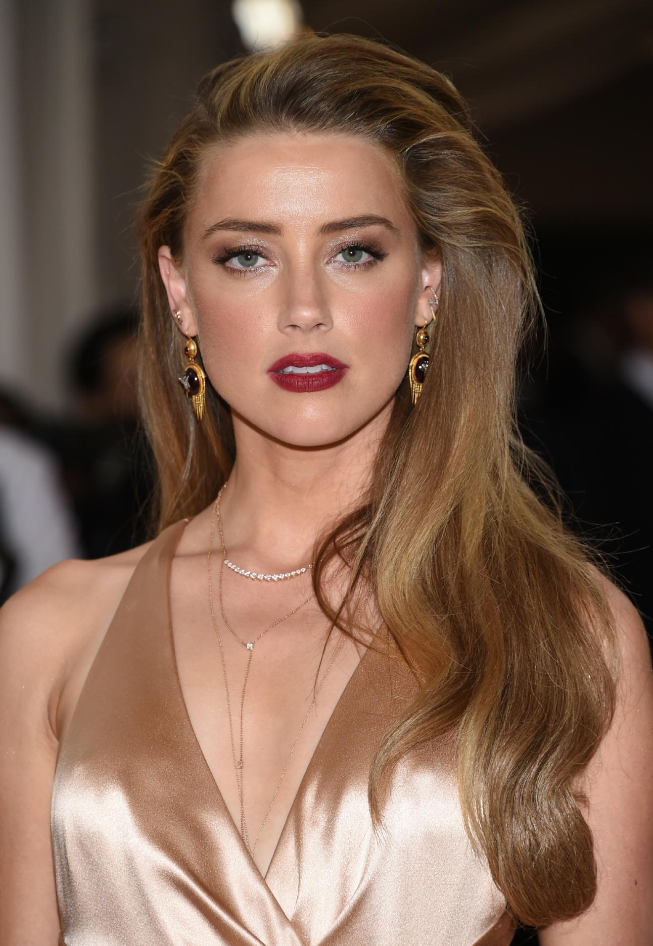 Amber Heard announces ... Amber Heard