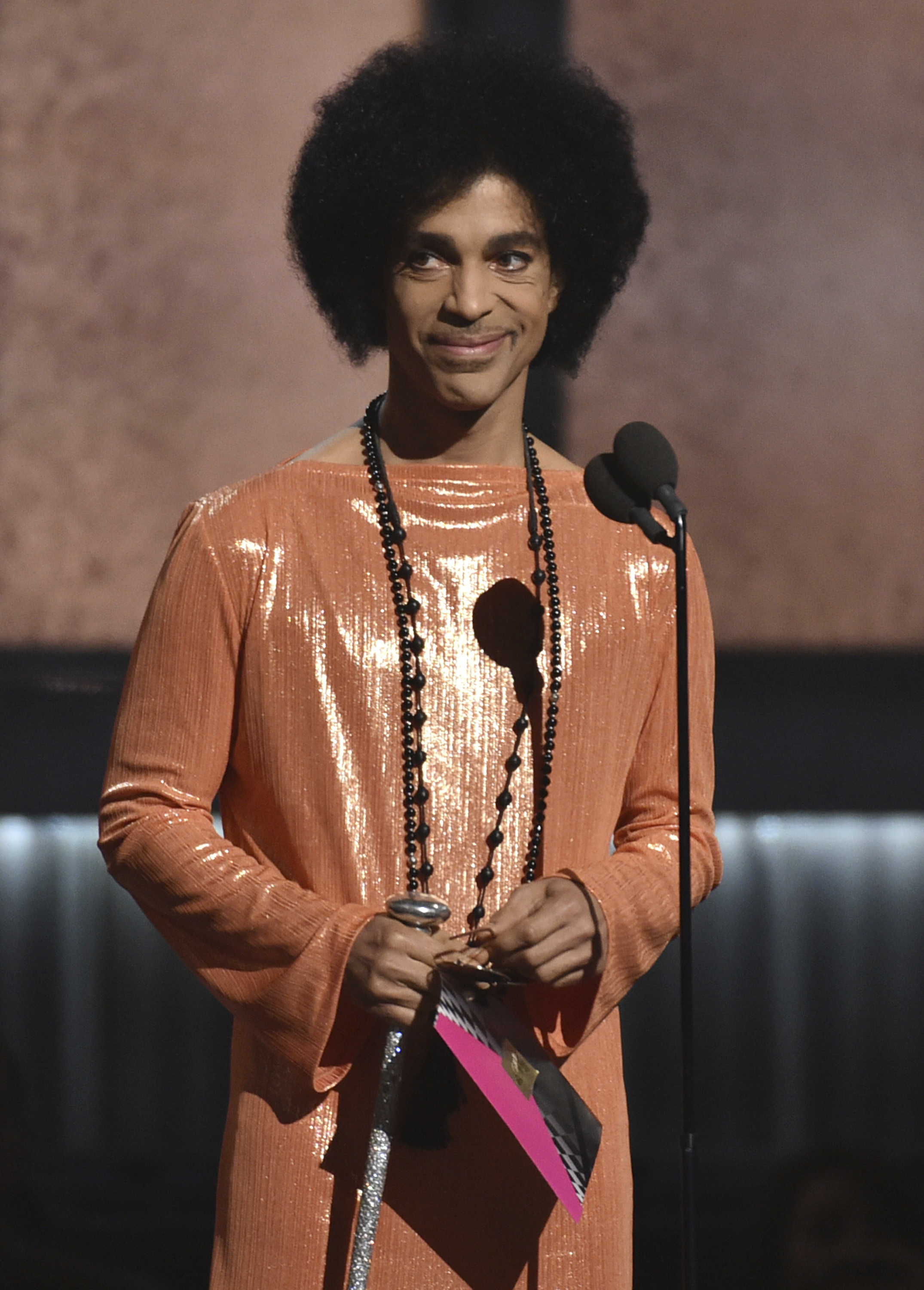 "File-This Feb. 8, 2015, file photo shows  Prince presenting the award for album of the year at the 57th annual Grammy Awards in Los Angeles. Prince didn't have an orange crush, purple was his favorite color, according to his half-sister.                  Sharon Nelson says in a statement Thursday, Aug. 31, 2017, to The Associated Press that ""contrary to what has been said, purple was and is Prince's color."" Tyka Nelson, Prince's only full sibling, told the London Evening Standard in a story published Aug. 21 that though people associate purple with the singer, his favorite color was orange. (Photo by John Shearer/Invision/AP, File)"