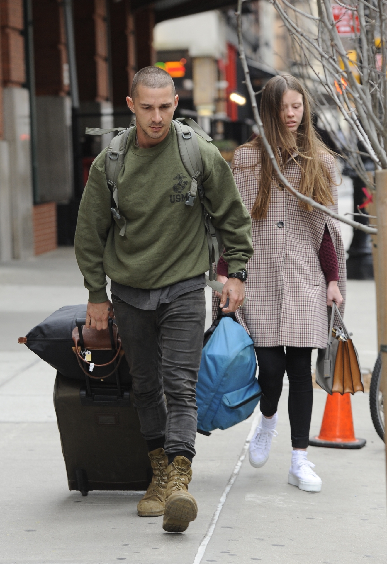 Shia LaBeouf and girlfriend Mia Goth leaving his hotel. Shia seen sporting short cropped hair and scruffy clothing as he wheels his luggage out.  Featuring: Shia LaBeouf,Mia Goth Where: Manhattan, New York, United States When: 25 Nov 2014 Credit: TNYF/WENN.com