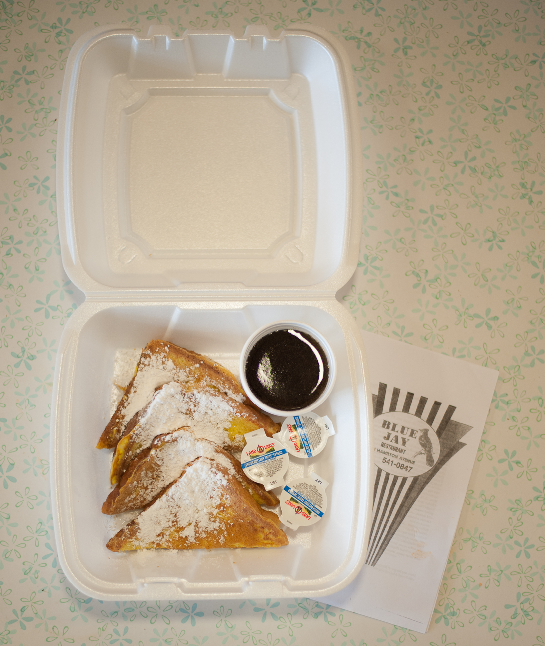 French Toast with butter, syrup, and powdered sugar / Image: Kellie Coleman // Published: 4.8.20