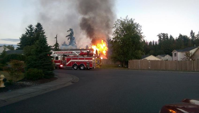 A fire burns a home in Graham on July 4, 2016 (Photo: Graham Fire & Rescue)