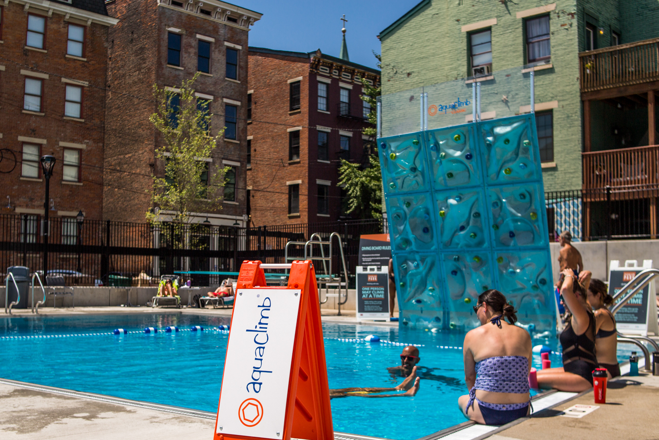 Ziegler Pool is a new public pool in Over-the-Rhine. It features a zero-depth entry in the shallow end, and a one-meter diving board in the deep end. A climbing wall bends slightly over the water, and the central part of the pool has five regulation swimming lanes. Restrooms, showers, concessions, and sit next to the pool. Children and seniors pay $2 per day, and adults (17-54 years old) pay $4. ADDRESS: 1322 Sycamore Street (45202) / Image: Catherine Viox // Published: 8.3.17