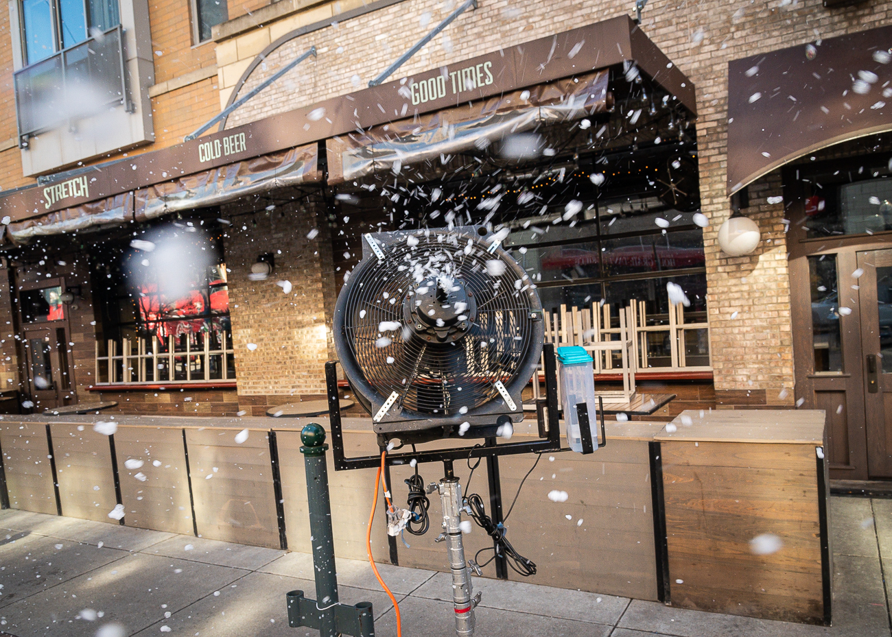 "Fans blow ""snow"" onto the street every half hour to create a blizzard effect. / Image: Phil Armstrong, Cincinnati Refined // Published: 1.6.20"