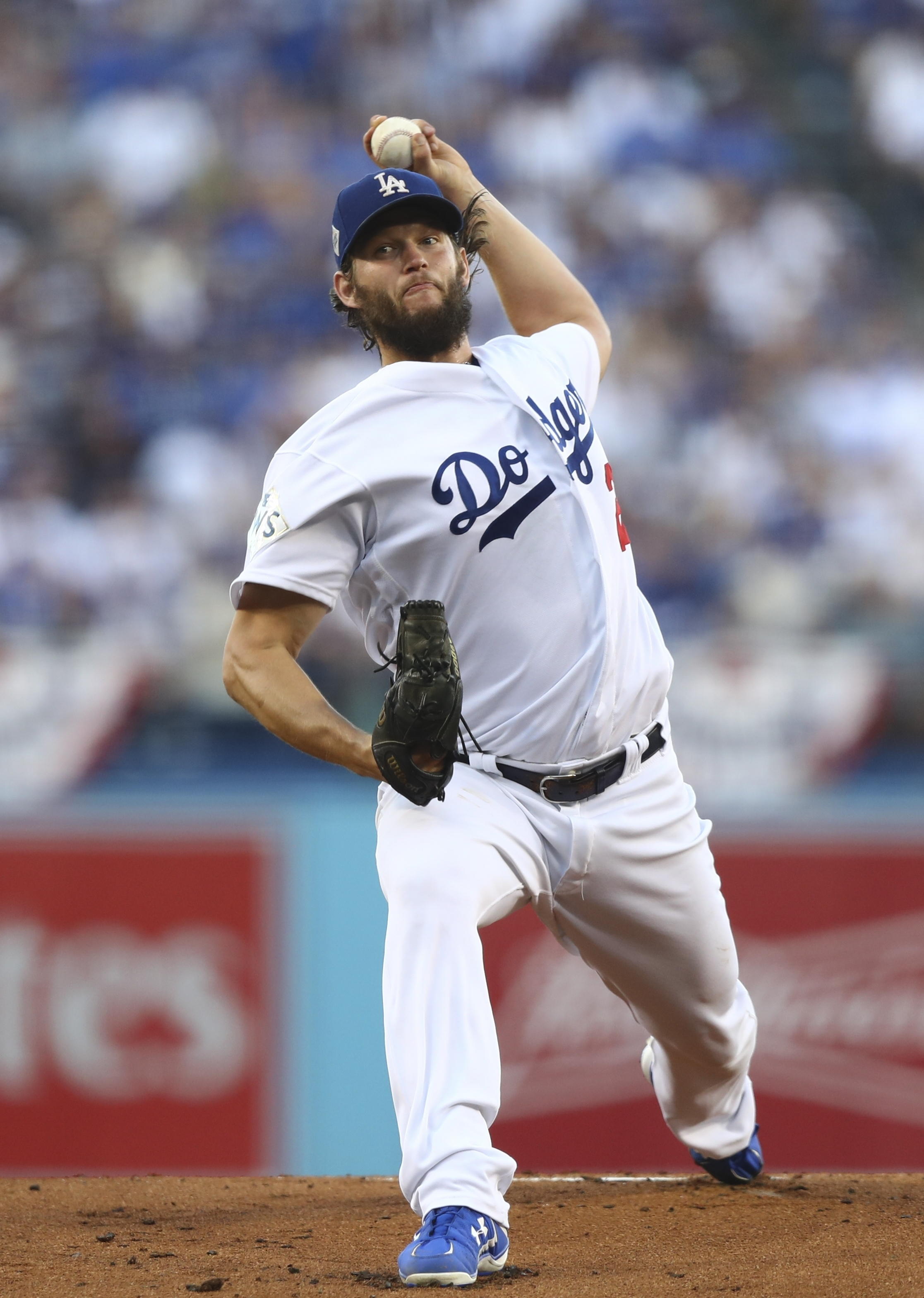 Los Angeles Dodgers starting pitcher Clayton Kershaw throws during the first inning of Game 1 of baseball's World Series against the Houston Astros Tuesday, Oct. 24, 2017, in Los Angeles. (AP Photo/Tim Bradbury, Pool)