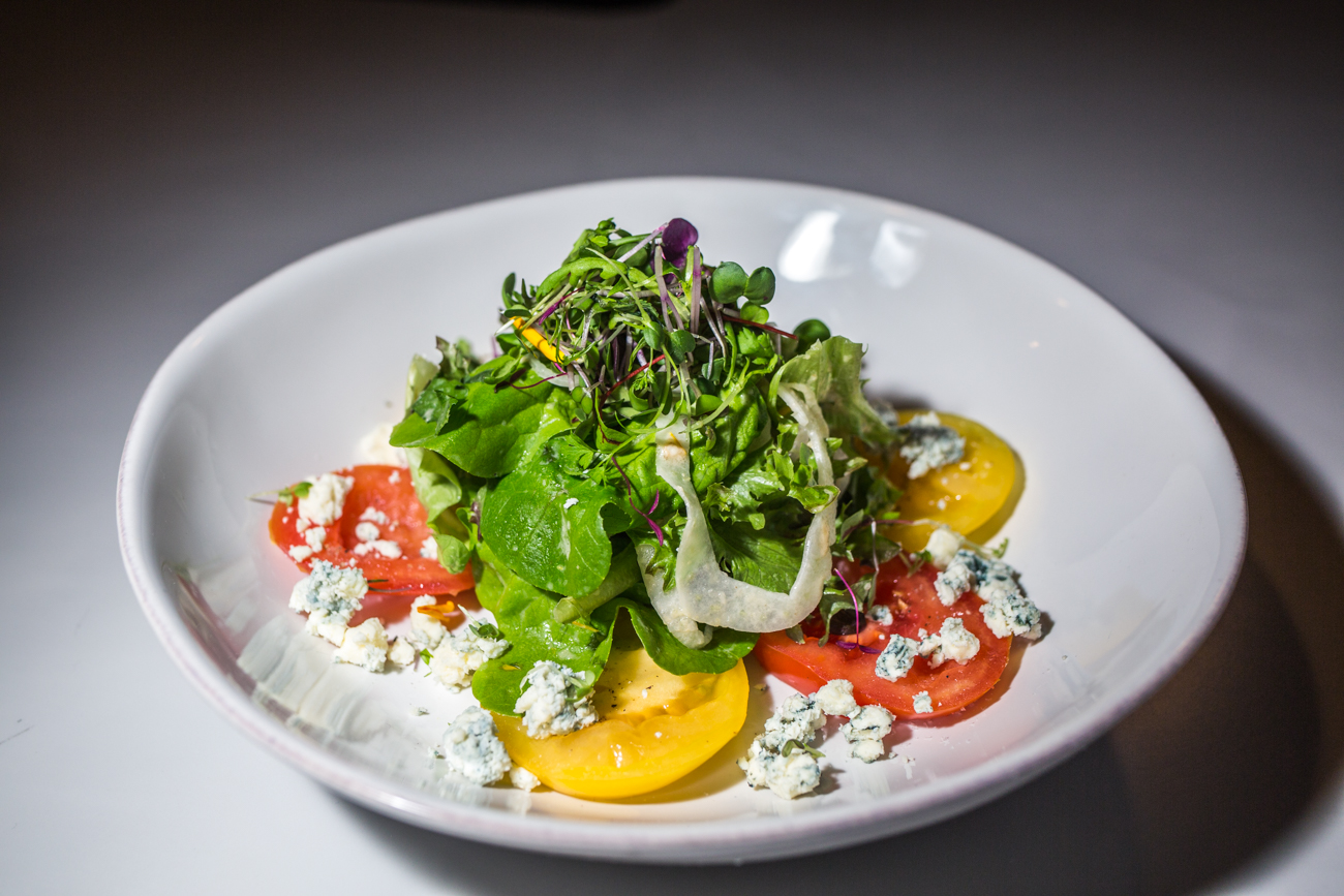 Vine-Ripe Salad: beefsteak tomato, blue cheese, fennel, with house-smoked tomato vinaigrette / Image: Catherine Viox // Published: 4.11.19