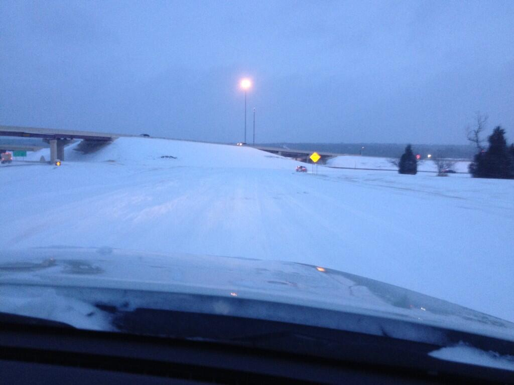 This is the ramp from I44 EB to I35 SB. The snow has almost entirelye wiped away the road.