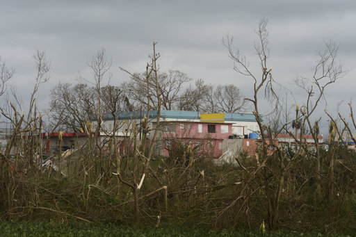Trees and buildings stand damaged after the passing of Hurricane Maria, in Yabucoa, Puerto Rico, Thursday, September 21, 2017. As of Thursday evening, Maria was moving off the northern coast of the Dominican Republic with winds of 120 mph (195 kph). The storm was expected to approach the Turks and Caicos Islands and the Bahamas late Thursday and early Friday. (AP Photo/Carlos Giusti)