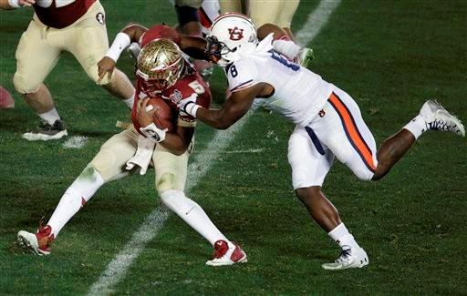 Auburn's Cassanova McKinzy (8) sacks Florida State's Jameis Winston (5) during the second half of the NCAA BCS National Championship college football game Monday, Jan. 6, 2014, in Pasadena, Calif.