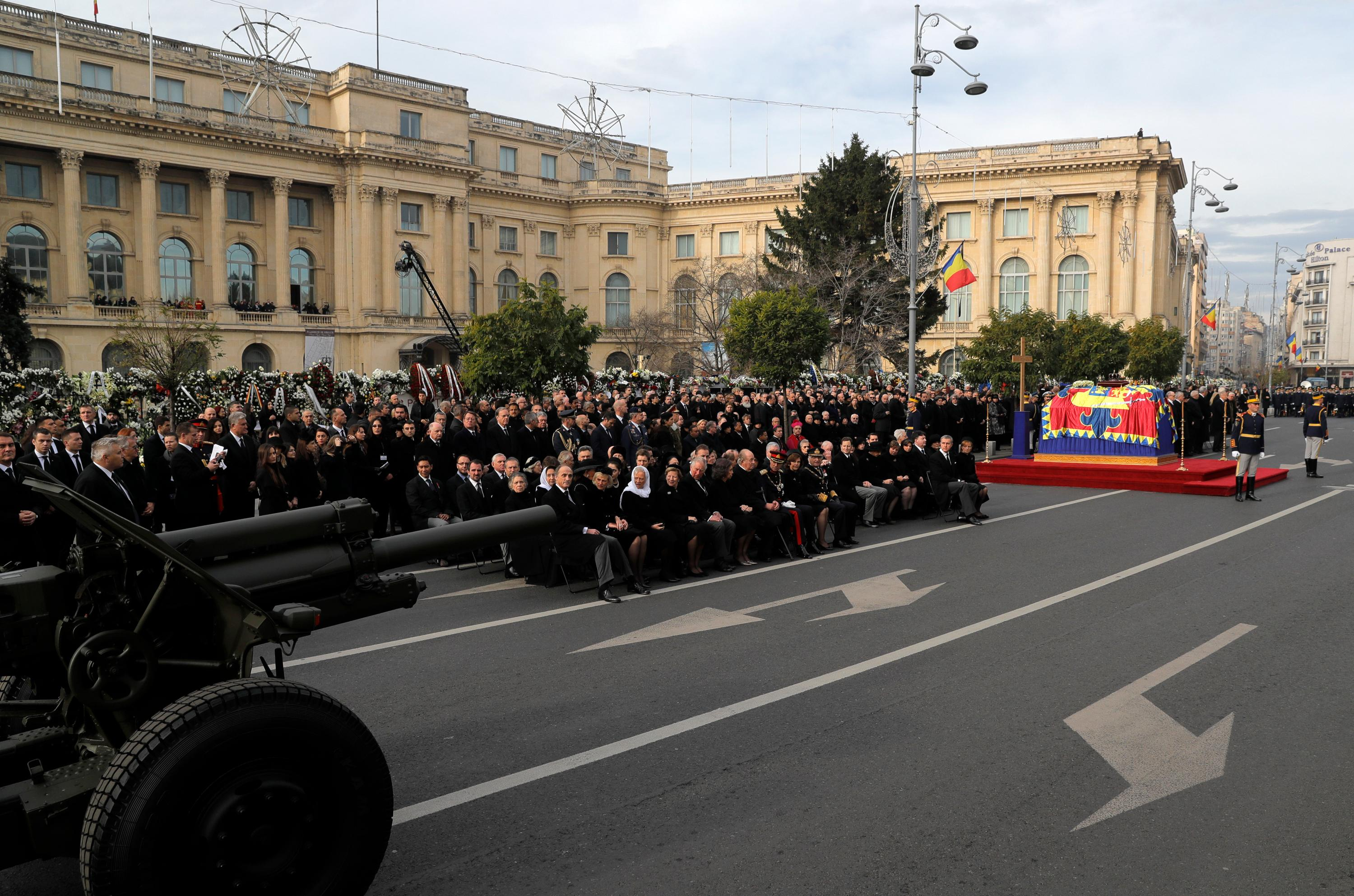 Honor guard next to the coffin of the late Romanian King Michael during the funeral ceremony outside the former royal palace in Bucharest, Romania, Saturday, Dec.16, 2017. Thousands waited in line to pay their respects to Former King Michael, who ruled Romania during WWII, and died on Dec. 5, 2017, aged 96, in Switzerland. (AP Photo/Vadim Ghirda)
