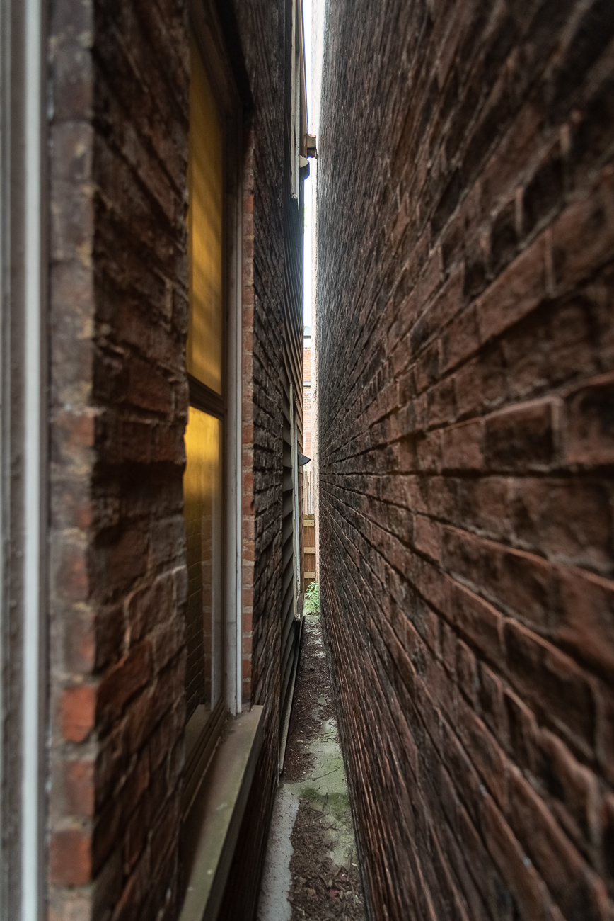 The house is so old, it doesn't align to the city's established grid. This causes the Betts House to angle inward when compared to its immediate neighbor. A doorway to this incredibly tight space illustrates its unique alignment. / Image: Phil Armstrong, Cincinnati Refined // Published: 9.6.19