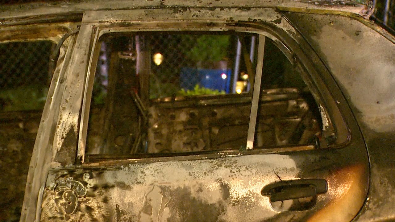 The charred remains of the car suspected to have been used in a deadly hit-and-run in Auburn. (Photo: KOMO News)