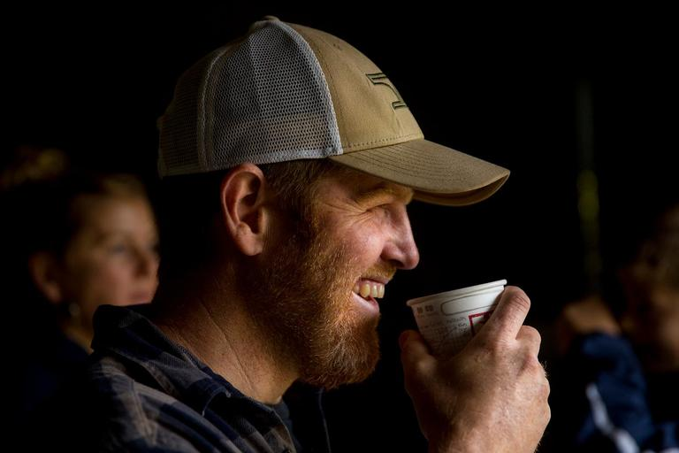Brady Turner, co-owner of the local restaurant Pickled Fish, sips a cup of coffee while take a break in the farm shed during the annual harvest at Starvation Alley Farms. (Sy Bean / Seattle Refined)