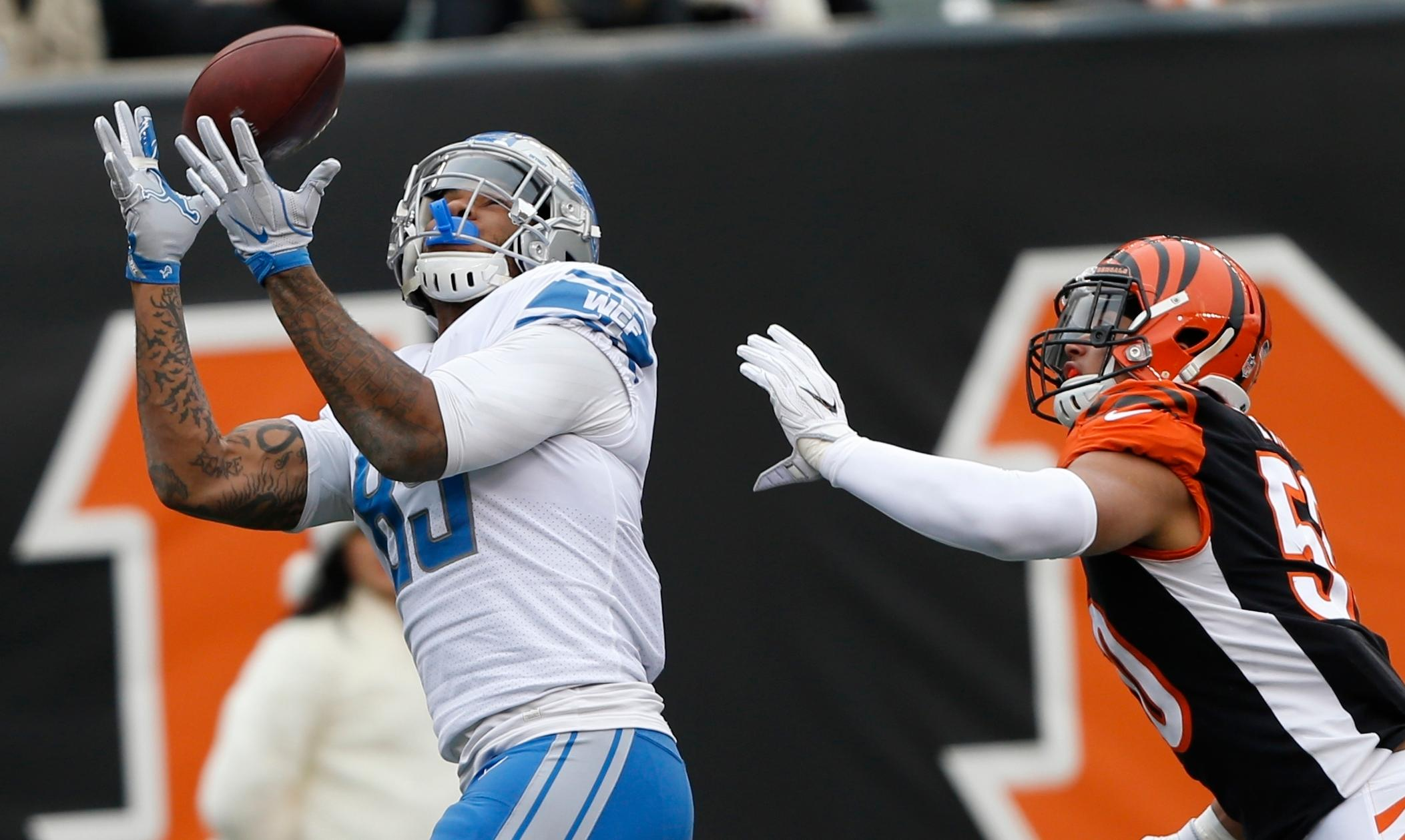 Detroit Lions tight end Eric Ebron (85) defended by Cincinnati Bengals linebacker Jordan Evans catches a 33-yard pass for a touchdown during the first half of an NFL football game, Sunday, Dec. 24, 2017, in Cincinnati. (AP Photo/Frank Victores)