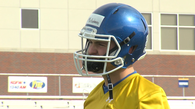 Alex McGinnis, a sophomore quarterback at UNK, warms up prior to practice, March 13, 2017 (NTV News)