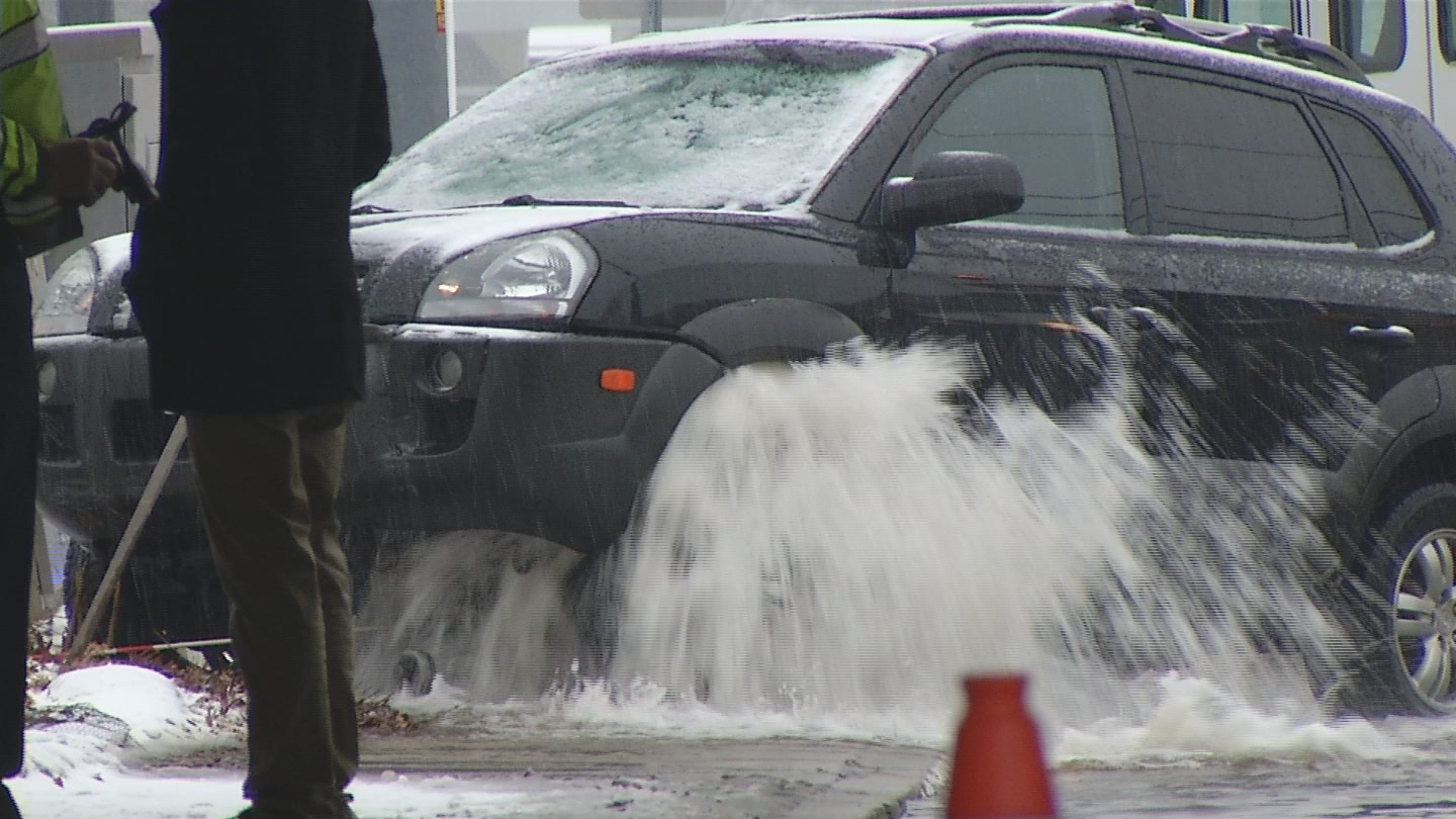 In Warwick, police say a car slid into a fire hydrant, causing water to gush all over the road on Wednesday, Feb. 7, 2018. (WJAR)<p></p>