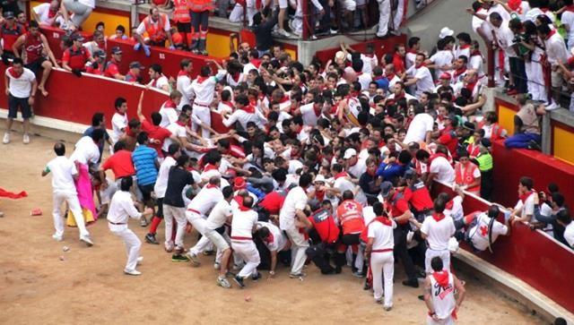Runners clog the entrance to the bull ring in Pamplona ahead of several bulls on July 13. The  clash between revelers and bulls resulted in several injuries.