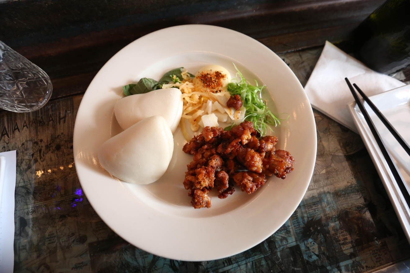 The fried chicken bao technically comes with two buns, but sharing isn't always caring. (Amanda Andrade-Rhoades/DC Refined)