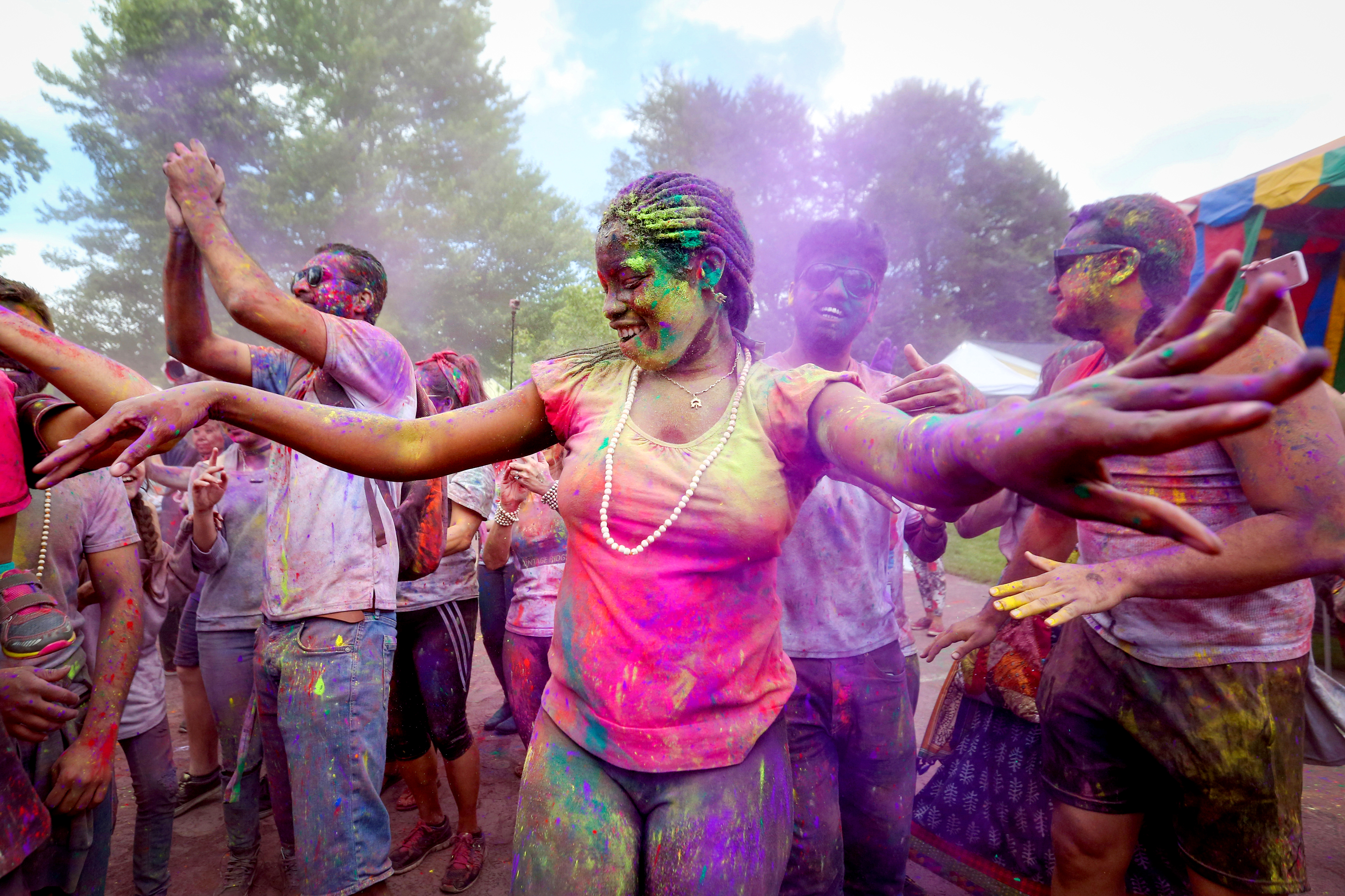 May, 2017. A woman dances in brightly colored powder at Holi.{&amp;nbsp;} (Amanda Andrade-Rhoades/DC Refined)<p></p>
