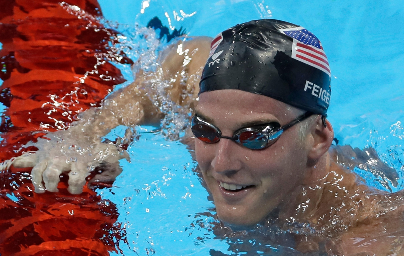 FILE - In this Aug. 2, 2016, file photo, United States James Feigen smiles during a swimming training session prior to the 2016 Summer Olympics in Rio de Janeiro, Brazil. Feigen was one of four American Olympic swimmers in connection to a story of being held at gunpoint and robbed several hours after the last Olympic swimming races ended. That claim began to unravel when police said that investigators could not find evidence to substantiate it. (AP Photo/Matt Slocum, File)