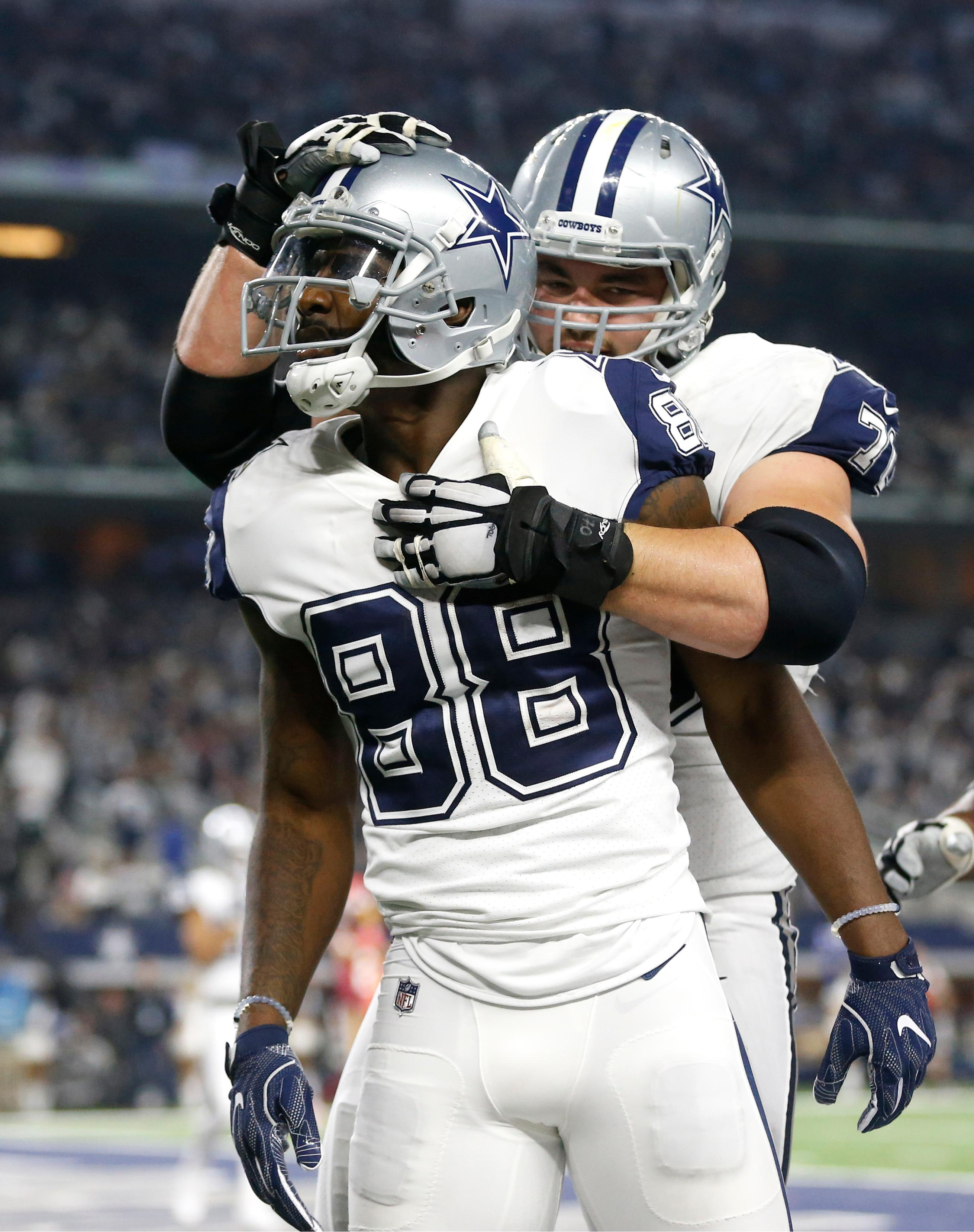 Dallas Cowboys wide receiver Dez Bryant (88) and guard Zack Martin, rear, celebrate a touchdown scored on a catch by Bryant in the second half of an NFL football game against the Washington Redskins on Thursday, Nov. 30, 2017, in Arlington, Texas. (AP Photo/Ron Jenkins)