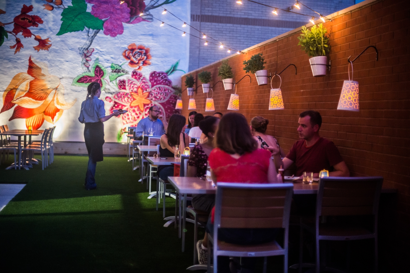 Little known fact: Hazel's outdoor space, with it's gorgeous floral mural,  has an inlaid floor which can double as a putting green! (Image: Rey Lopez)