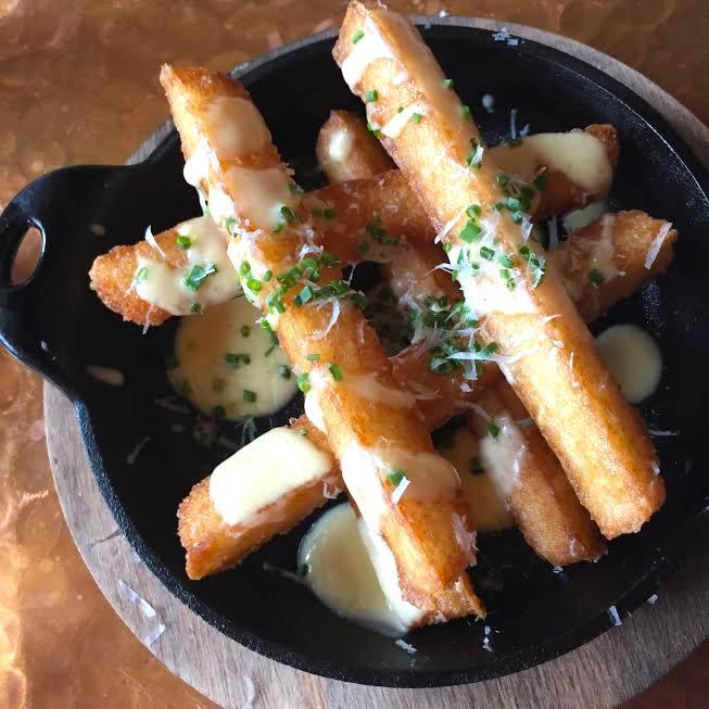 Move over, French fries. Chef Austin Fausett at Proof has made an even more decadent baton of golden, brown and delicious in the form of risotto fries smattered with bone marrow hollandaise, parmesan shavings, chives and truffle oil. It's available at brunch, and if you're really drowning your sorrows, also order the bacon-cinnamon sticky buns. (Image: Rina Rapuano)