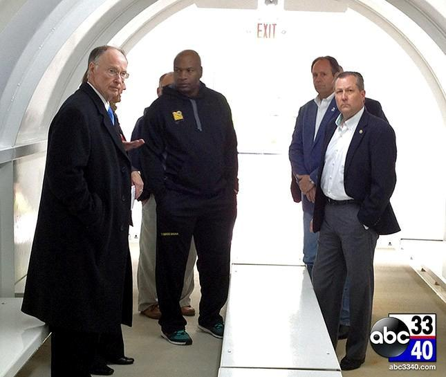 Gov. Robert Bentley, Bo Jackson and other state leaders tour a storm shelter in Chilton County, Ala., Tuesday, April 15, 2014.