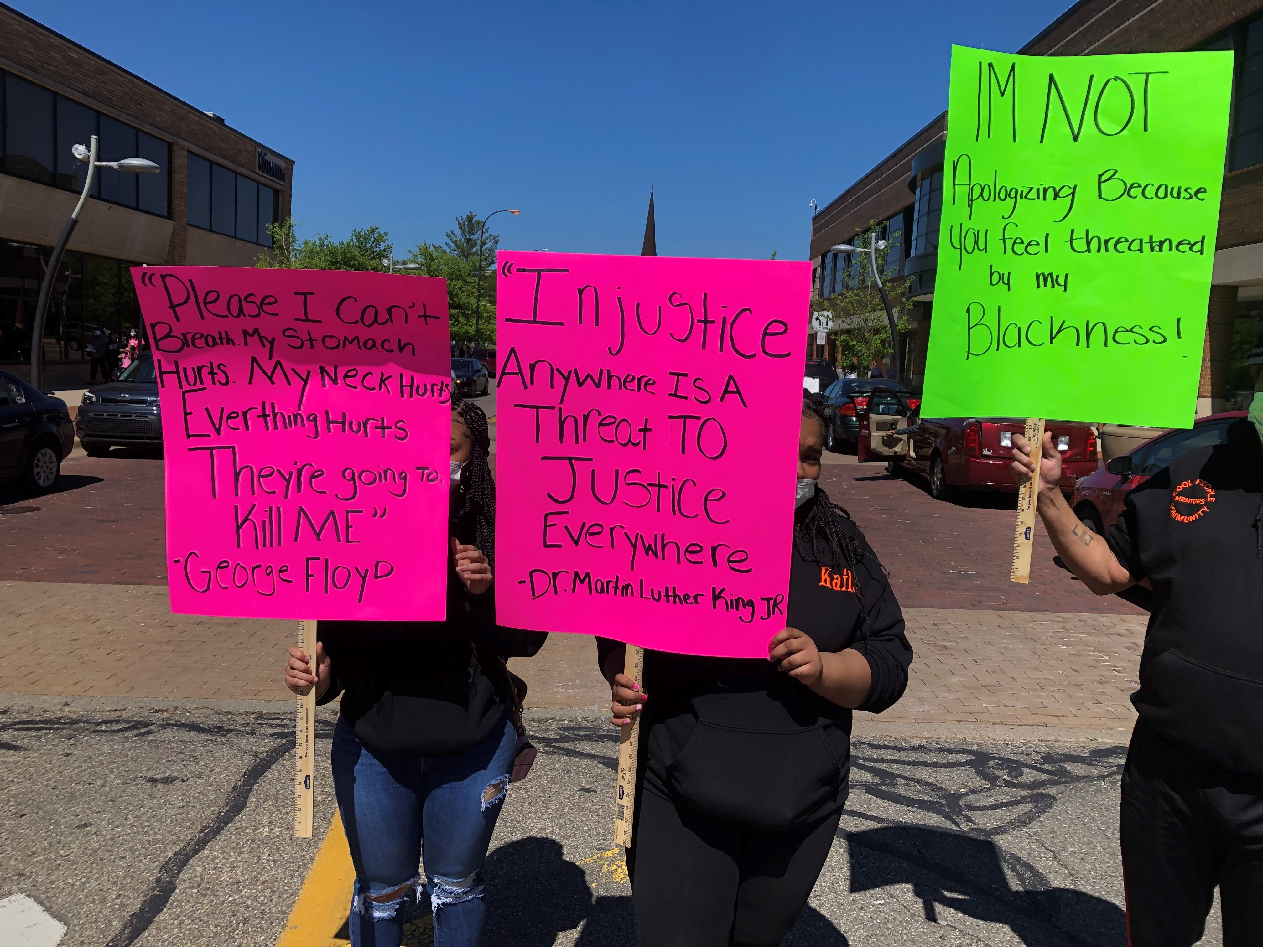 On Sunday, May 31, 2020 people walked throughout the streets of Battle Creek with signs protesting the death of George Floyd.(WWMT/Sam Knef)