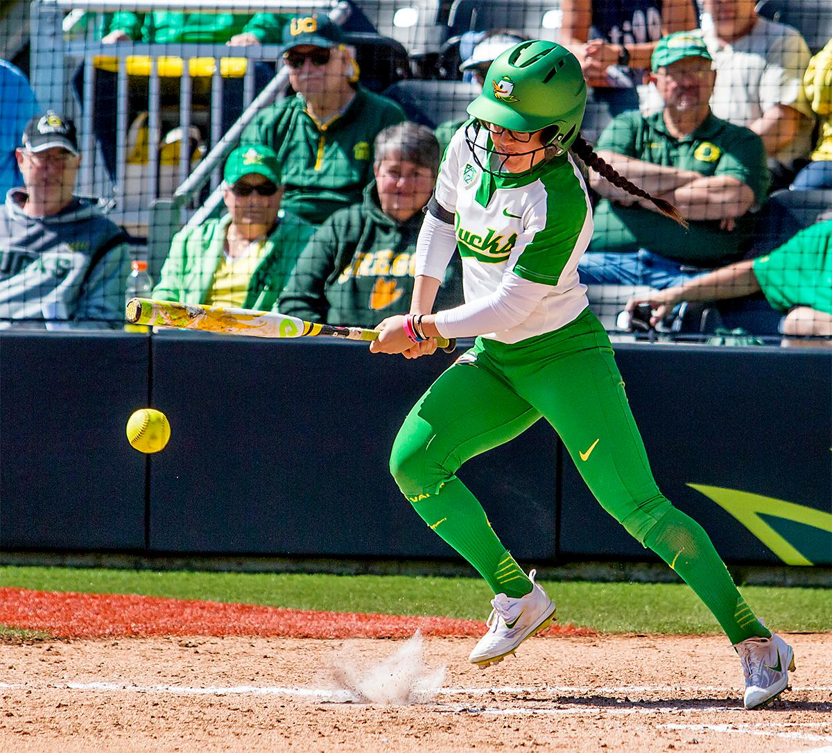 The Duck's Danica Mercado (#2) takes a swing at the ball. The Oregon Ducks Softball team took their third win over the Arizona Sun Devils, 1-0, in the final game of the weekends series that saw the game go into an eighth inning before the Duck?s Mia Camuso (#7) scored a hit allowing teammate Haley Cruse (#26) to run into home plate for a point. The Ducks are now 33-0 this season and will next play a double header against Portland State on Tuesday, April 4 at Jane Sanders Stadium. Photo by August Frank, Oregon News Lab